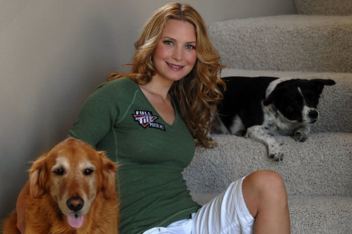 Erica Schoenberg (blackjack babe) sitting with dogs